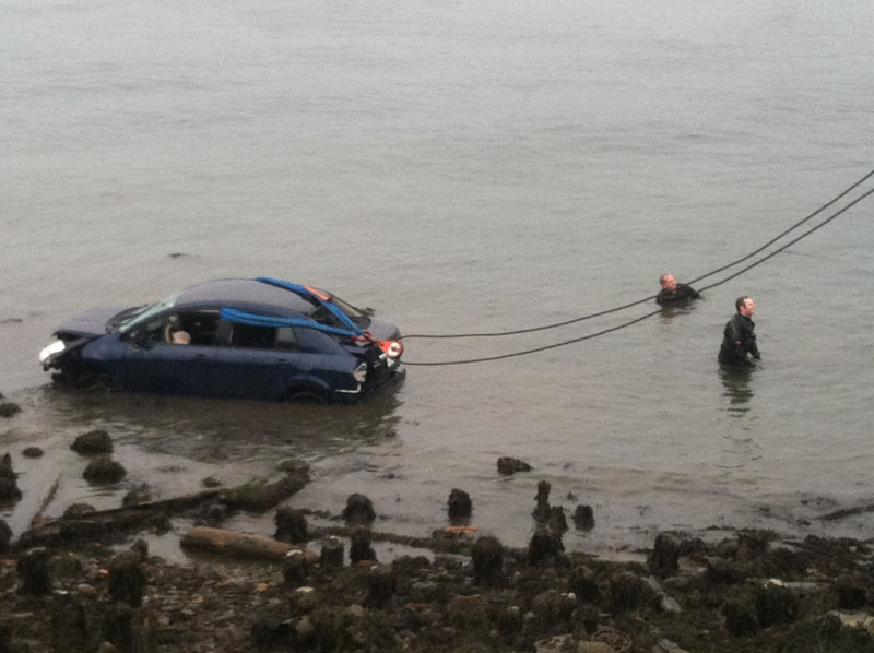 A car is pulled from the water near Ocean Gateway in Portland at the end of India Street.