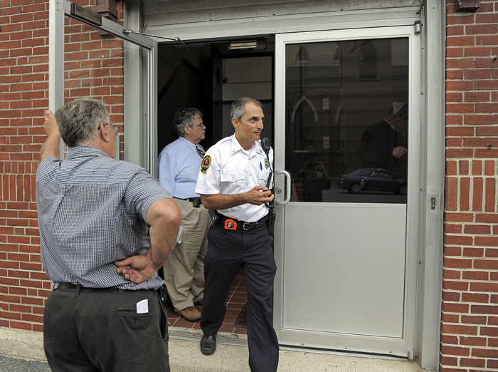 Captain Chris Pirone of the Portland Fire Department exits the Cathedral School on Cumberland Avenue Tuesday after performing checks on the sprinkler and alarm systems.