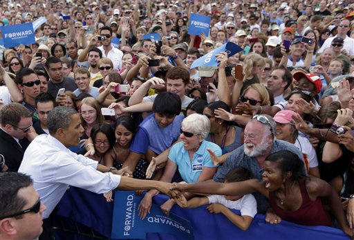 President Barack Obama reaches over to greet supporters during a campaign event at University of Colorado Boulder, Sunday, Sept. 2, 2012, in Boulder, Colo. (AP Photo/Pablo Martinez Monsivais)