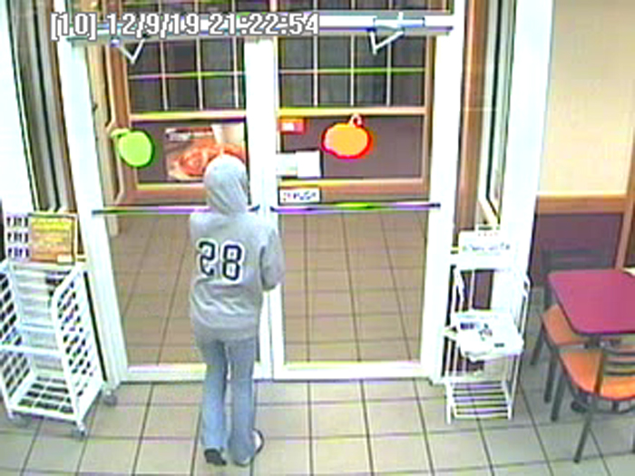 Surveillance image shows robbery suspect leaving the store.