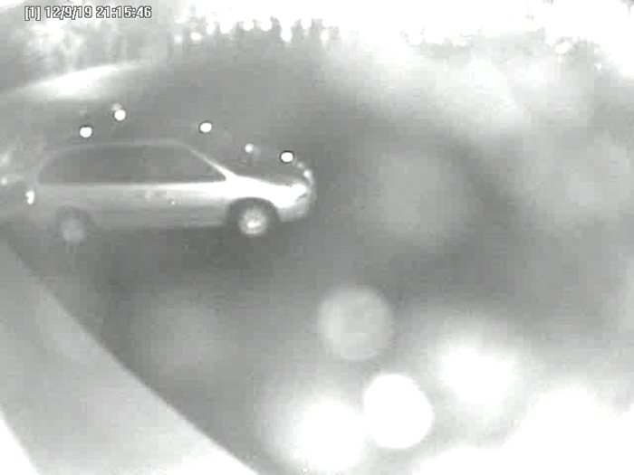 An exterior surveillance camera shows the vehicle police believe was used by the robber.