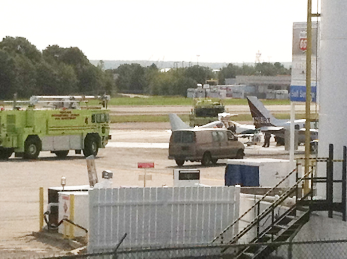 Firefighters respond to fire on small plane at the Portland Jetport this morning.