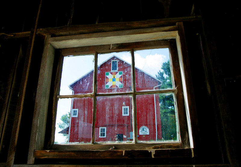 The barn at the Crown Point Ecology Center in Bath Township, Ohio, is adorned with a painted art quilt.