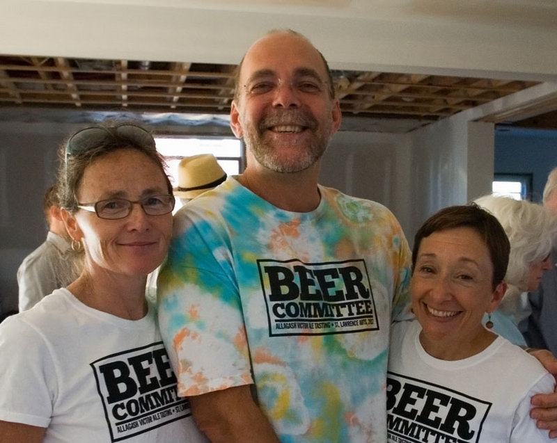 Deirdre Nice, Drew Masterman and Nan Cumming celebrate the $11,000 raised by Allagash Brewing Co. for St. Lawrence Arts at a party last week at the Portland home of Chris Akerlind.