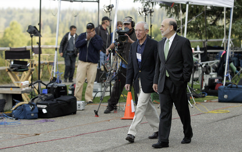 Federal Reserve Chairman Ben Bernanke, right, and Bank of Israel Gov. Stanley Fischer walk past TV cameras Friday outside of the Jackson Hole Economic Symposium at Grand Teton National Park in Wyoming.