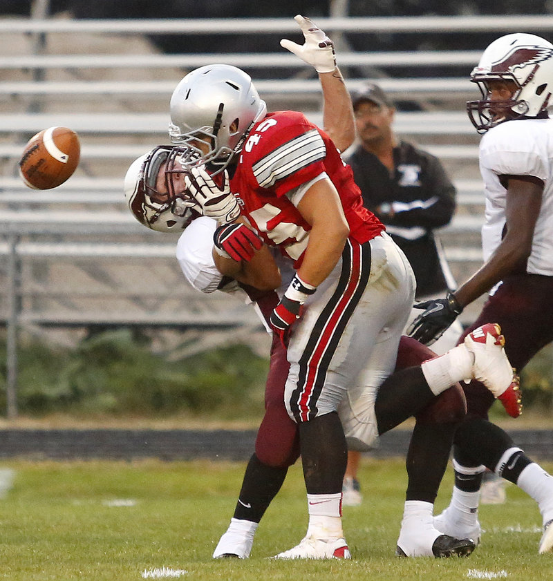 Matt Hammond, foreground, of South Portland breaks up the play as Colby Waterhouse of Windham attempts to make a first-quarter reception.