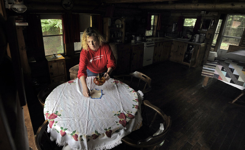 Christine Howe, Black's wife, sets a table at the business that provides the couple with extra income.