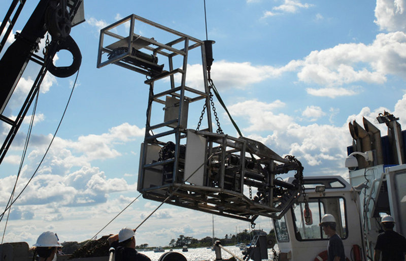 Seahorse, a state-of-the-art underwater mapping camera, is loaded onto a research vessel in Lewes, Del. Developed to get better information about scallops, Seahorse has proved useful in capturing details of other marine life, too.