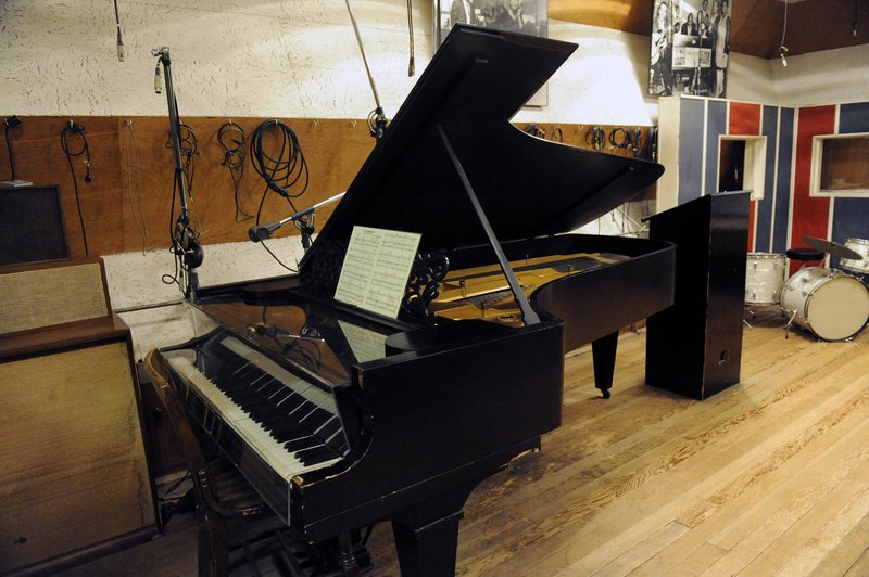 An 1877 Steinway grand piano is seen in a Motown recording studio in Detroit. Ex-Beatle Paul McCartney, below, will soon perform on one that he paid to have restored.