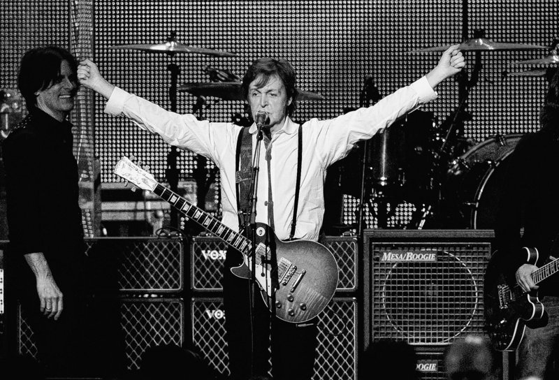 Paul McCartney performs at the MusiCares Person of the Year gala in his honor in Los Angeles on Feb. 10. The former Beatle will be decorated with the rank of officer by French President Francois Hollande in a ceremony Saturday in Paris.
