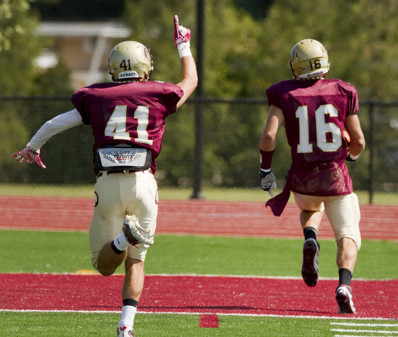 Josh Cyr of Thornton Academy shows his enthusiasm as teammate Andrew Libby reaches the end zone on a punt return.