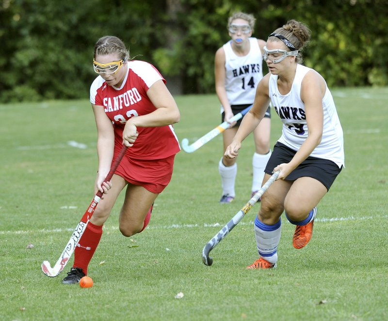 Caroline L'Heureux, left, of Sanford is the lone holdover in the SMAA from last year's all-state team.