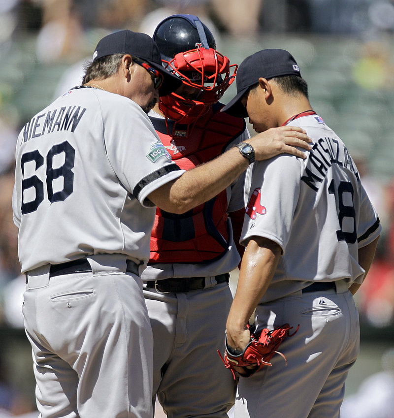 Daisuke Matsuzaka, right, gets a visit from Boston pitching coach Randy Niemann, left, and catcher Ryan Lavarnway in the third inning on Sunday.