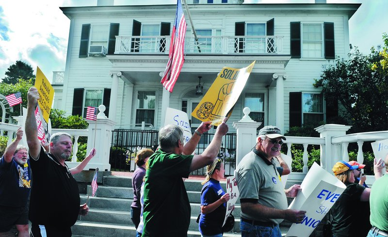 Labor supporters march Sunday in front of the Blaine House in Augusta during a Labor Day celebration with workers from Maine unions. Marchers walked around the governor's mansion and then gathered in Capitol Park for a cookout. Monday is Labor Day.