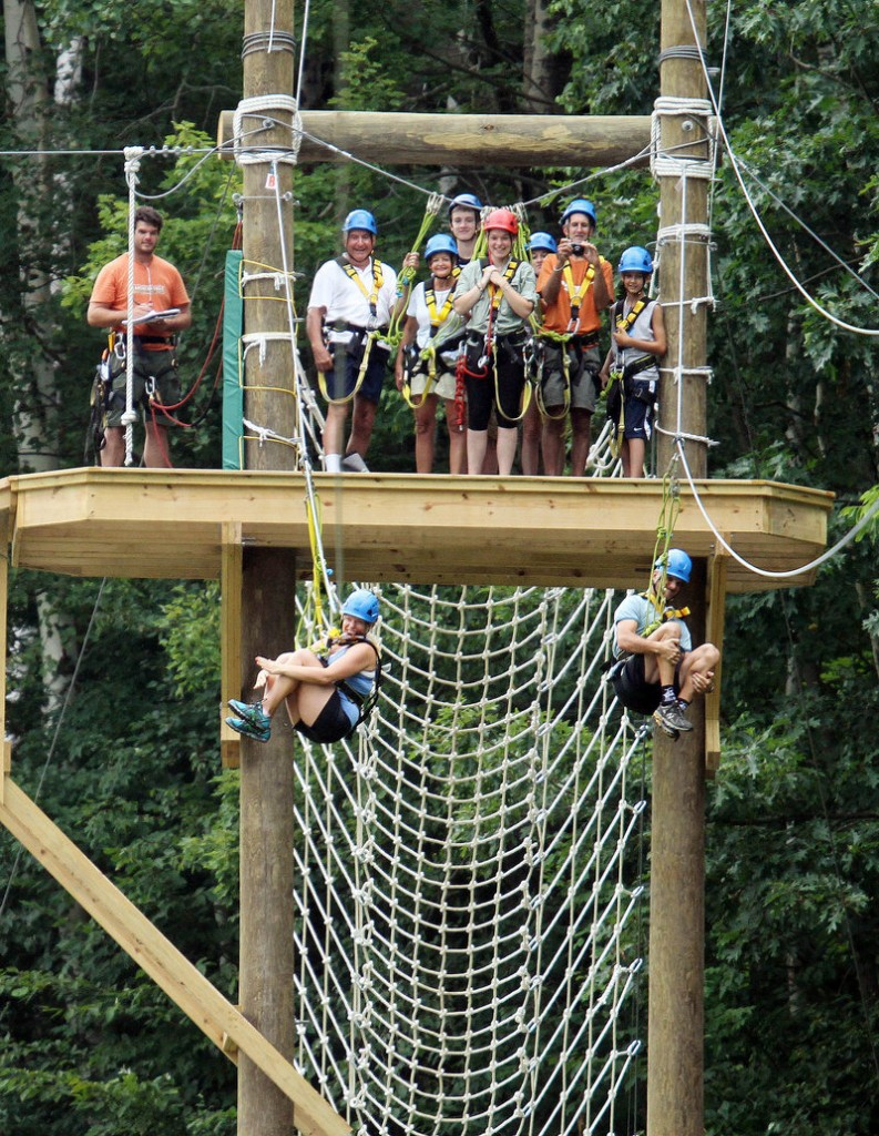 Zip lines at Mount Sunapee ski area in Newbury, N.H. attract summer visitors. Ski areas throughout New England have added year-round recreational features, including water parks and ice hockey arenas.