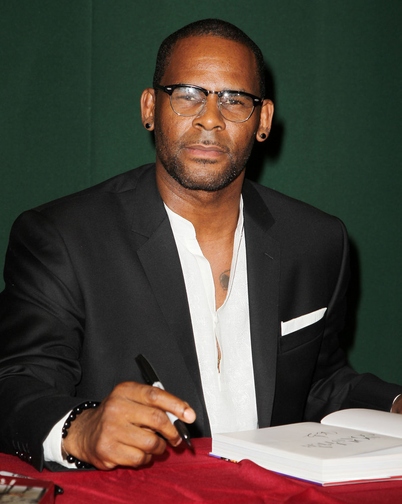 R&B singer R. Kelly, seen signing copies of his memoir,