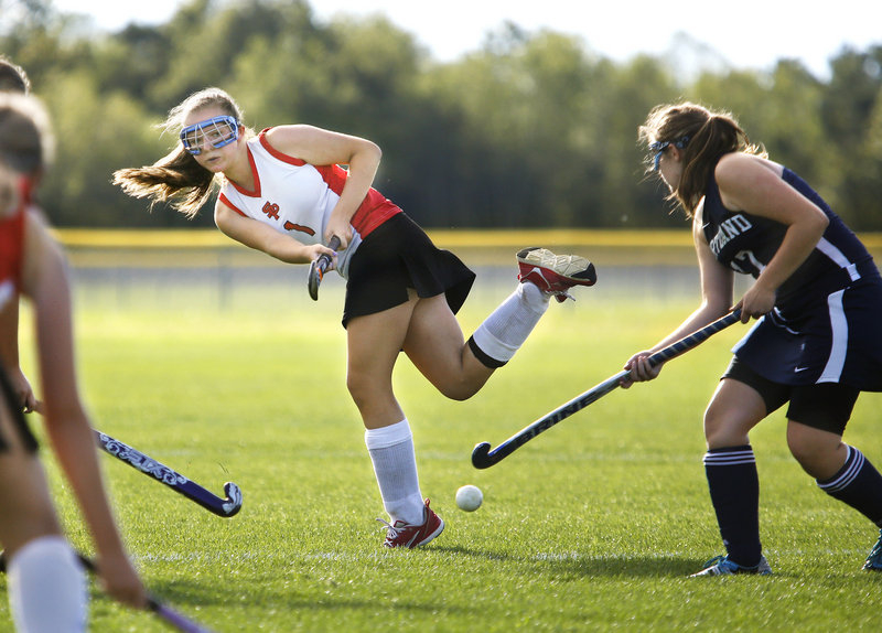 Jaclyn Salevsky of South Portland crosses the ball to a teammate as Tara O'Neal of Portland defends. South Portland improved to 1-1 and dropped Portland to 0-3.