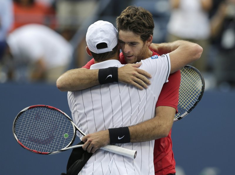 Juan Martin del Potro hugs Andy Roddick after beating him in the fourth round of the U.S. Open on Wednesday. Roddick has said he will retire after the tournament.