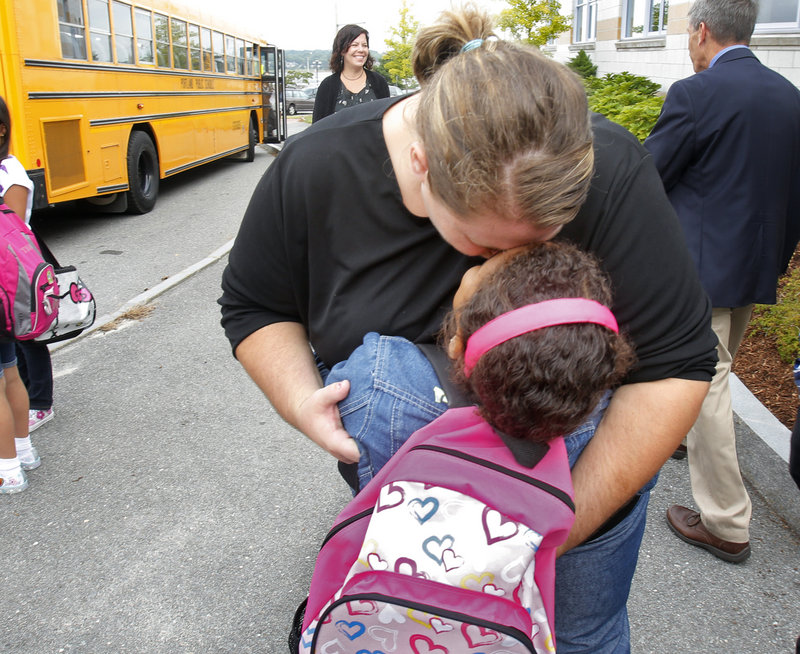Kate Nelson hugs her daughter Kerra Brown before the first grader heads into Eat End School on Thursday, Sept. 6, 2012.