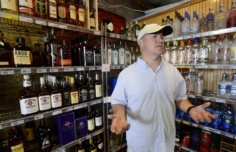 Doug Weber, owner of Downeast Beverage in Portland talks about the liquor business at his store on Commercial Street on Thursday, Sept. 6, 2012.