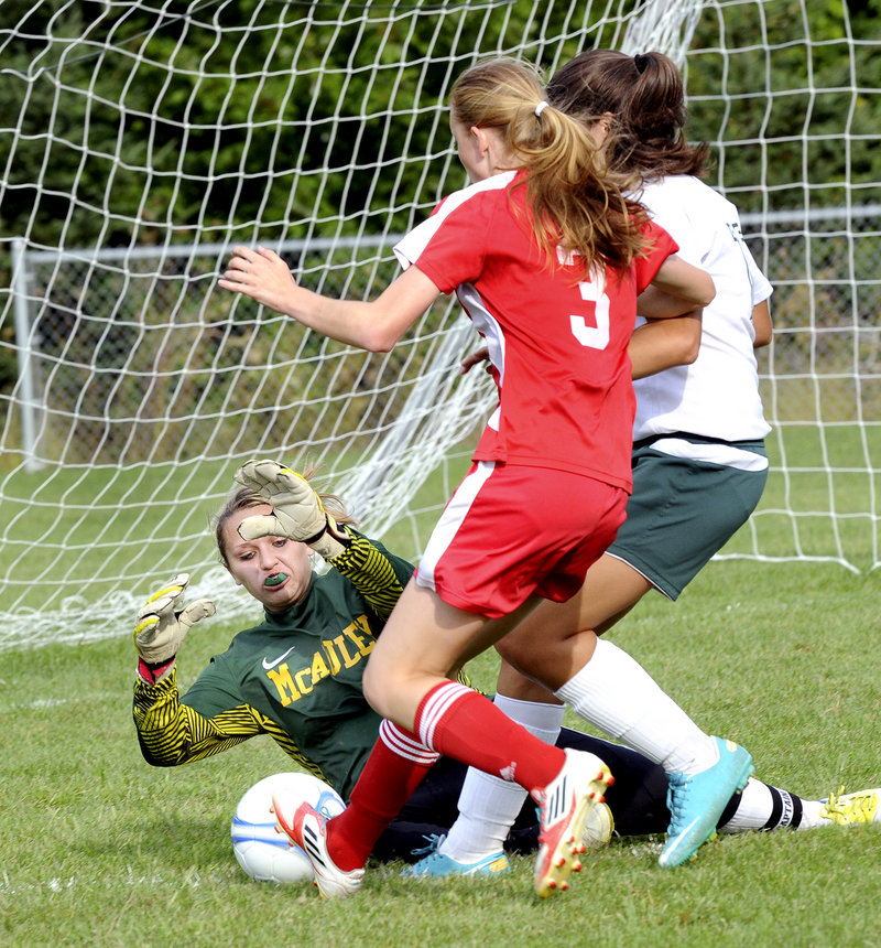 McAuley goalie Molly Miller makes a save as Sanford's Rachel Fink, 3, closes in for a possible rebound. Sanford, now known as the Spartans, breezed to a 7-2 win.