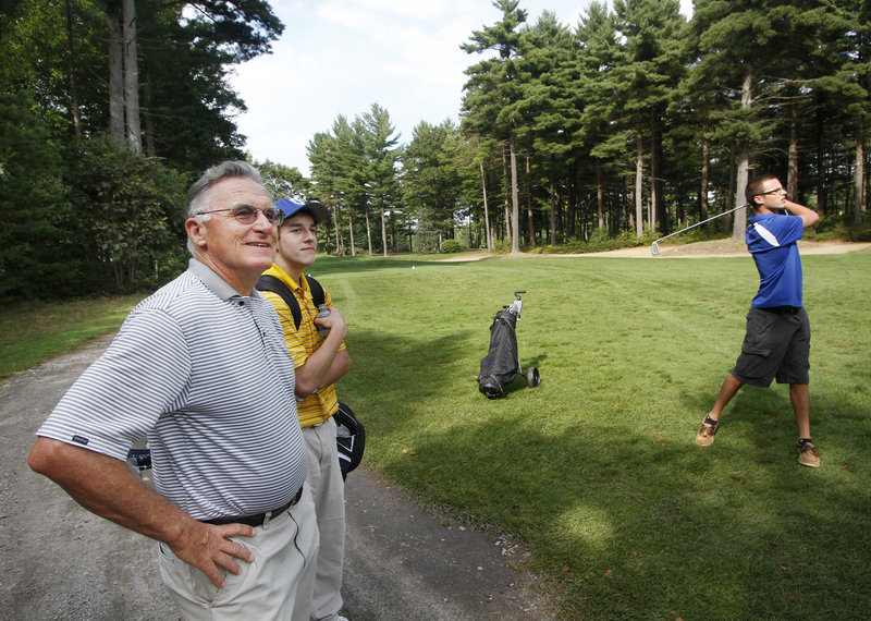 Bryce Roberts, a longtime golf pro and the new coach at Old Orchard Beach, watches one of his first-year players, Anthony Langella, practice at Dunegrass Golf Club.
