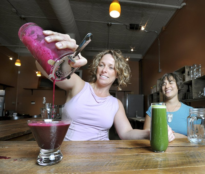 Kathleen Flanagan, left, and Jeanette Richelson have opened Roost House of Juice on Free Street in Portland, serving all organic, gluten-free and raw juices, smoothies, breakfast, snacks, light meals and wine.