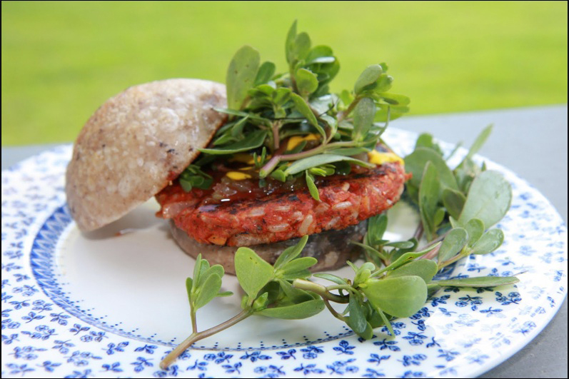 A simple and tasty veggie burger made with chickpeas, rice, chopped onions, tomato paste and seasonings.
