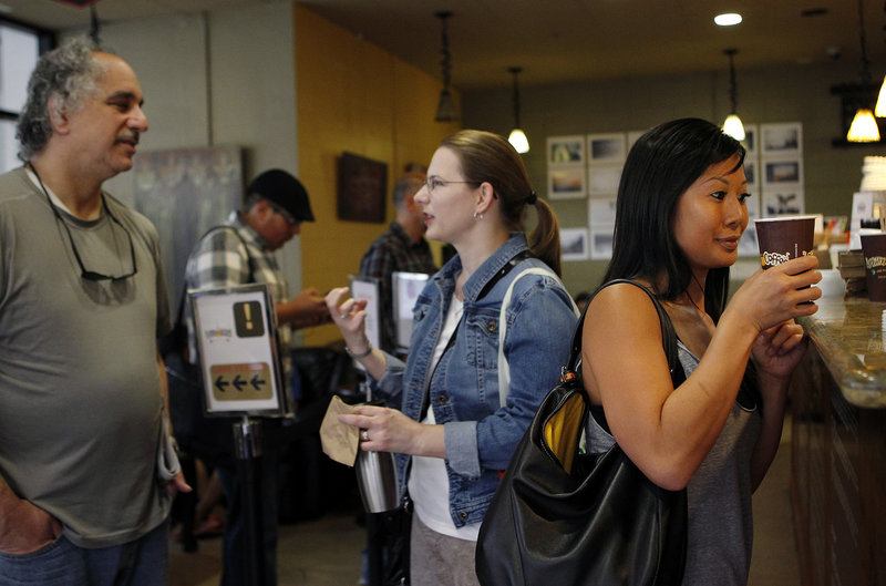 Joann Truong, right, picks up her Philharmonic coffee at Philz Coffee in San Jose, Calif. Philz is part of the so-called Third Wave in the coffee industry.