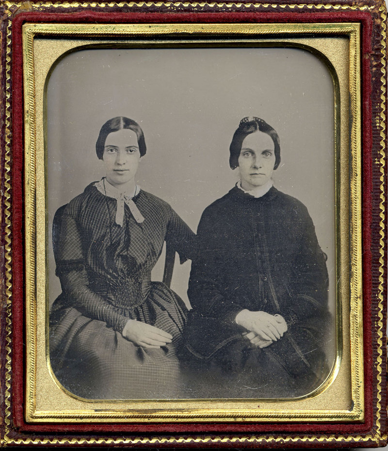 This photo released Friday, Sept. 7, 2012 by Amherst College Archives and Special Collections, and the Emily Dickinson Museum, in Amherst, Mass., shows a copy of a circa 1860 daguerreotype purported to show a 30-year-old Emily Dickinson, left, with her friend Kate Scott Turner.