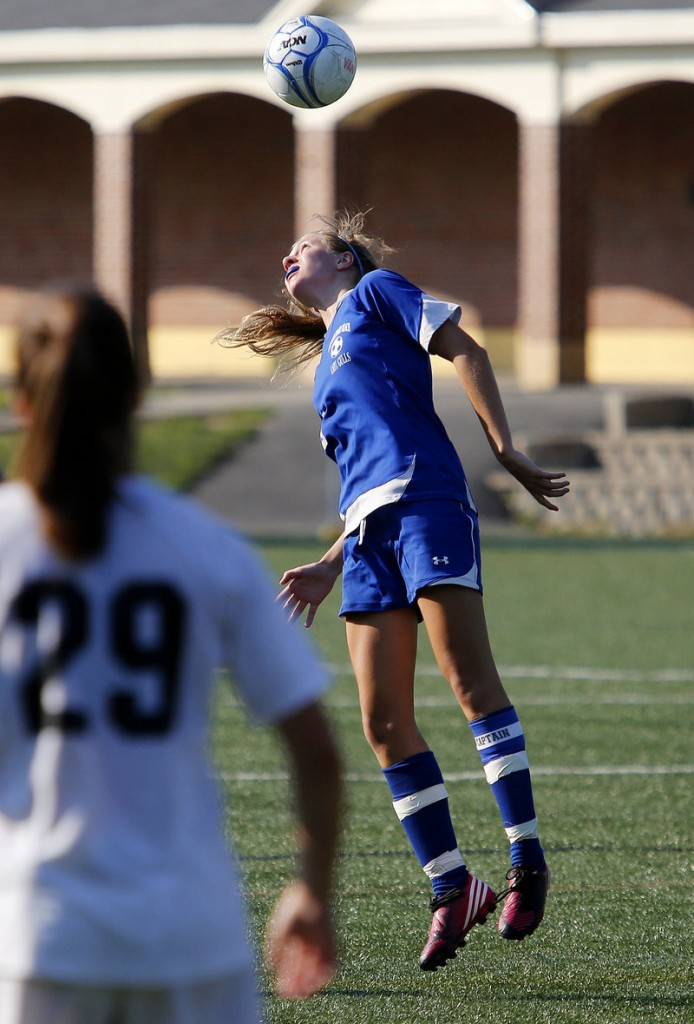 Anna Foss of Old Orchard Beach goes up for a header during her team's victory over NYA.
