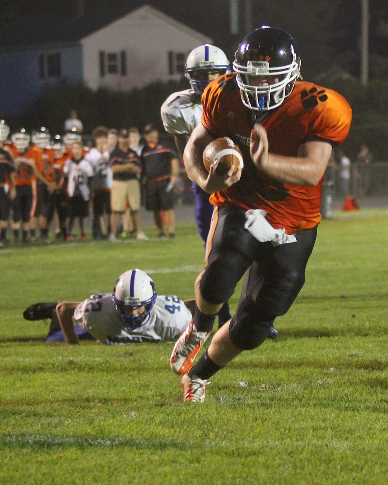 Seth Wing of Gardiner finds a huge hole up the middle Friday night to score on a 9-yard run in the second quarter and give the Tigers a 28-0 lead against Morse. Gardiner went on to a 31-8 victory at home.
