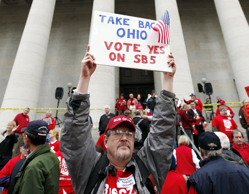 White, working class voters, particularly those from the Midwest, are becoming increasingly important to both President Obama and former Massachusetts Gov. Mitt Romney. Here, Richard Ringo, a member of a coalition of over 60 tea party groups across Ohio, demonstrates at the Ohio Statehouse in February.