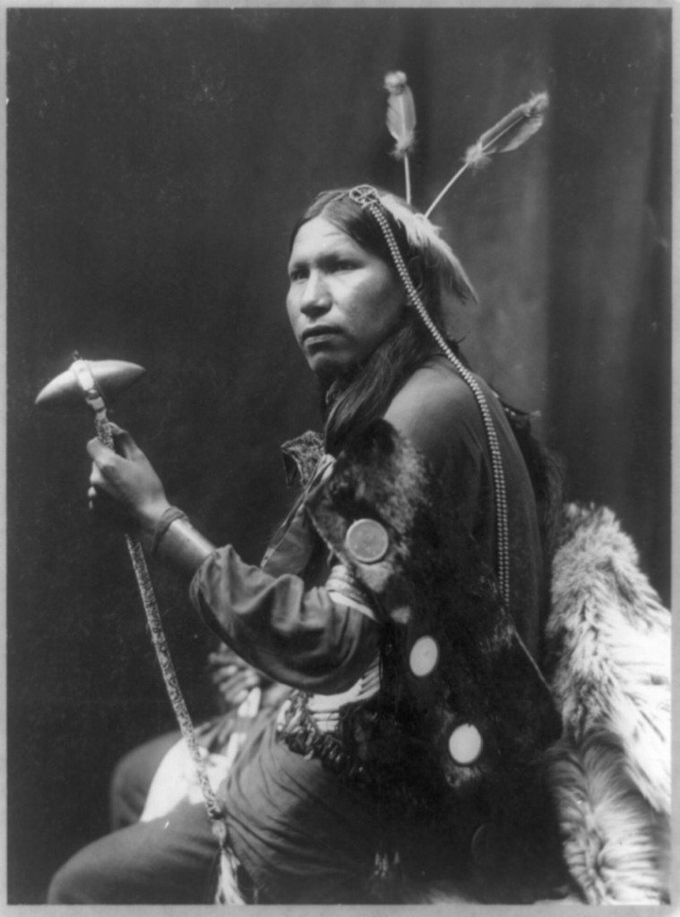 This 1899 portrait by George Heyn, provided by the Library of Congress, shows Albert Afraid of Hawk holding a tomahawk while touring with Buffalo Bill's Rough Riders.