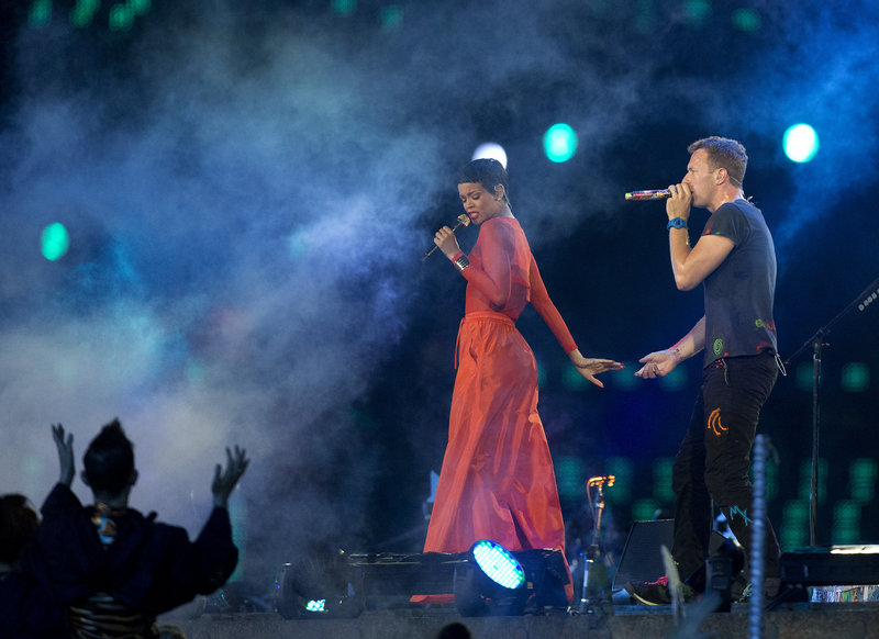 Rihanna performs with Chris Martin, lead vocalist of Coldplay, during the closing ceremony for the 2012 Paralympic games Sunday in London.