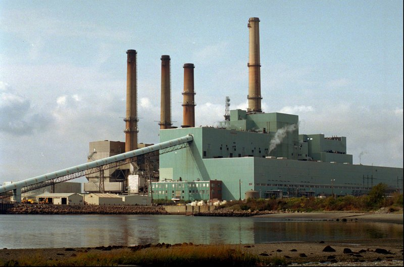 The Brayton Point Power Station in Somerset, Mass., is shown in this 1996 file photo. The plant, located on Mount Hope Bay across the mouth of the Taunton River, employs 215 people and can provide power to 1.5 million people at full capacity, its owner says.