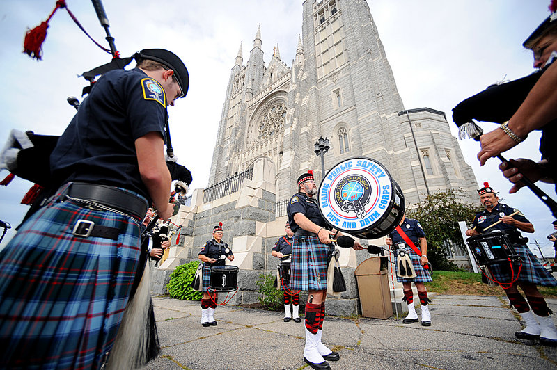 Members of the Maine Public Safety Pipe and Drum Corps play Sunday outside the Basilica of Saints Peter and Paul in Lewiston before the start of the Blue Mass. The annual Blue Mass pays tribute and offers blessings to Maine's law enforcement, fire and emergency medical personnel and is held in September to remember those who lost their lives on Sept. 11, 2001. It was organized by Maine's Roman Catholic Diocese.