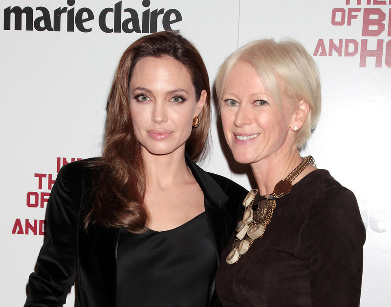 """This Dec. 6, 2011, file photo shows actress Angelina Jolie with Joanna Coles, editor-in-chief of Marie Claire magazine, at a special screening of her film """"In The Land of Blood and Honey,"""" sponsored by the magazine in New York. Jolie is scheduled to visit Jordan's first tent city for Syrian refugees on Tuesday morning."""