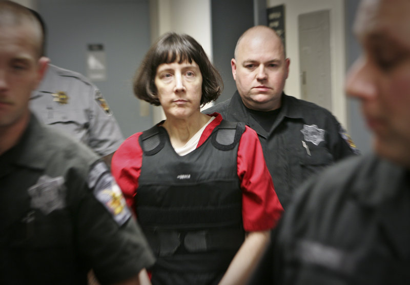 Amy Bishop is escorted through a courthouse Tuesday in Huntsville, Ala. She pleaded guilty to killing three co-workers and wounding three and is facing multiple life sentences.