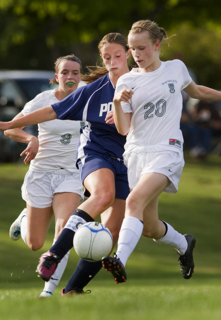 Waynflete freshman Arianna Giguere, right, attempts to keep the ball from Paxton Arsenault of Poland during their 2-2 tie in girls' soccer Tuesday.