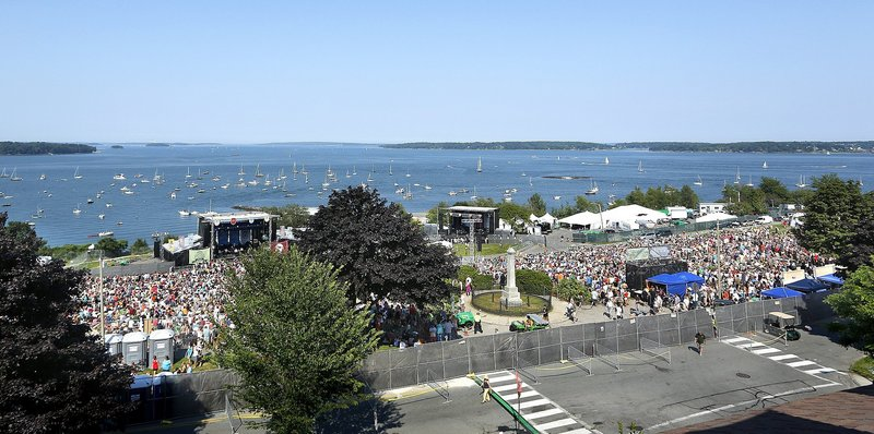 """Thousands gathers on Portland's Eastern Promenade for the """"Gentlemen of the Road"""" music festival earlier this summer. This city and Munjoy Hill residents are debating whether to host more large concerts on the Promenade in future years."""