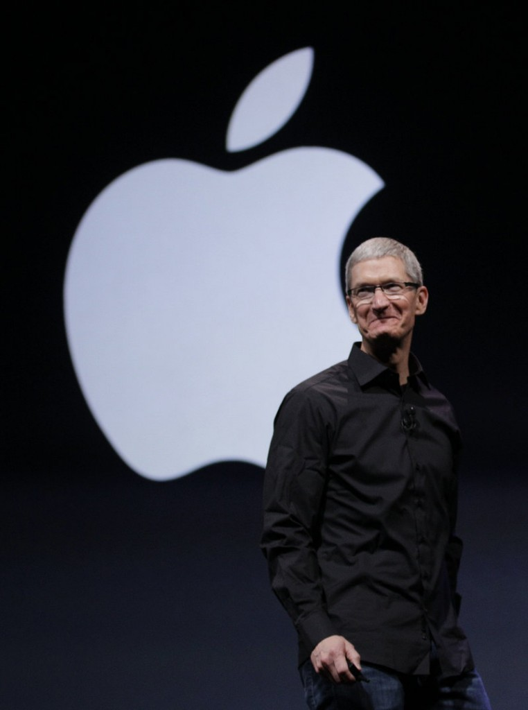 Apple CEO Tim Cook introduces the upgrades in the iPhone 5 in San Francisco on Wednesday.