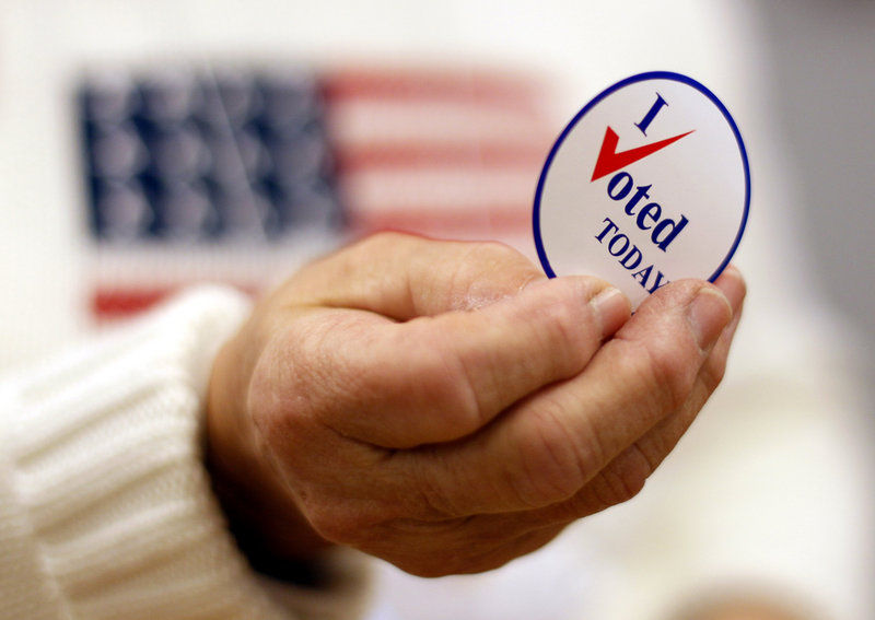 """Saying """"I voted"""" on Facebook may influence more people to get out to the polls than wearing the traditional sticker."""