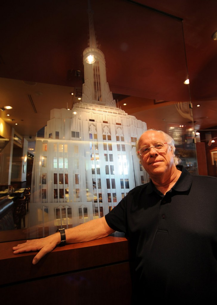 Investor Michael Caplan stands near an etched-glass panel of the Empire State Building at a Florida deli.