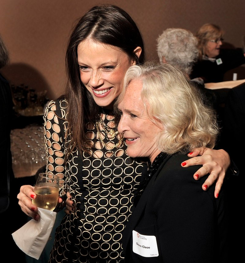 Actress Glenn Close shares a hug with model/actress Hani Avital at the cocktail reception prior to Maine Creative Industries Award Gala on Thursday, Sept. 13, 2012 at the Holiday Inn By the Bay in Portland.