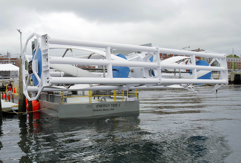 In this June 13, 2011 file photo, the Energy Tide 2, the largest tidal-energy turbine ever deployed in the U.S., appears on a bare in Portland, ME. North America's first-ever tidal turbine started supplying energy to the grid on Sept. 13, 2012, generating power from the bottom of Cobscook Bay in Maine.