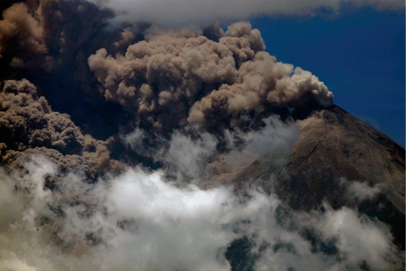 Volcanic ash spews from the Volcan de Fuego after the long-simmering volcano erupted, forcing the evacuation of more than 33,000 people from surrounding communities.