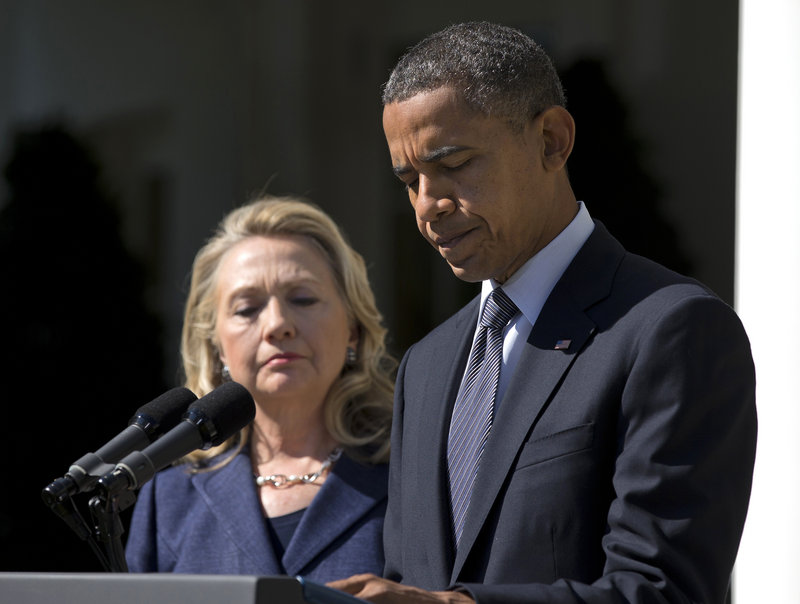 President Obama, accompanied by Secretary of State Hillary Rodham Clinton, speaks in the Rose Garden of the White House in Washington about the death of U.S. ambassador to Libya Christopher Stevens.