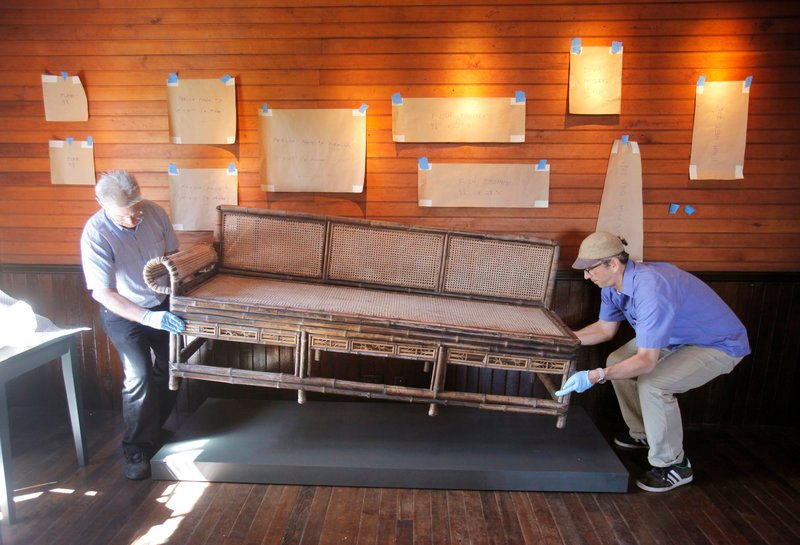 During the restoration, Greg Welch and Kris Kenow, preparators with the Portland Museum of Art, arrange pieces at Winslow Homer's studio at Prouts Neck this spring.