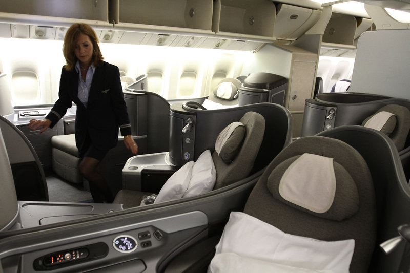 The updated first class section of a United Boeing 777 offers more leg room, seats that go completely flat for sleeping and nicer remote controls for movies. But the added space in first and business classes means more seats squeezed into coach sections.